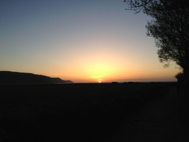 The sun sets over Porlock Bay. Photo by Elke Winzer