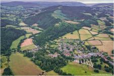 0708-stuart-warstat-dunster-village-and-castle-with-grabbist-hill-and-dunkery-in-the-distance