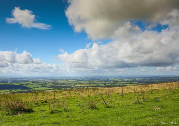 On top of the world with expansive views. Looking towards the North Devon Coastline. Photo by Simon Dibble