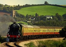 0911 Peter Mather The Flying Scotsman approaching Blue Anchor with Old Cleeve church in the back ground. Photo by Peter W Mather.